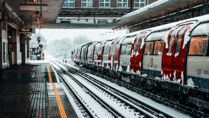 London underground train in train station covered in snow