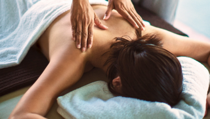 Woman getting a massage at Marriott Hotel Relaxation Day