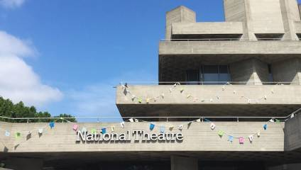 Exterior of National Theatre in London with bunting