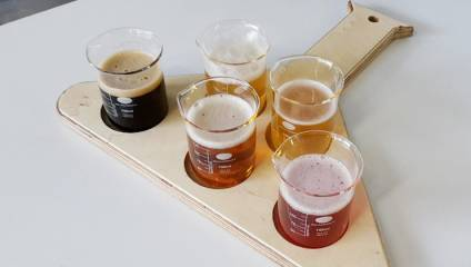 Platter with tasting glasses of craft beer