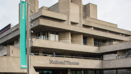 Grey brutalist theatre building in London. National Theatre.